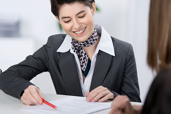 receptionist showing guest paperwork